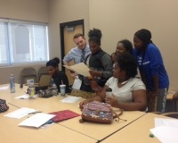 Student producers of the middle school project working on scripts.