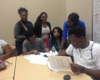 Student producers for the high schools project working on scripts.